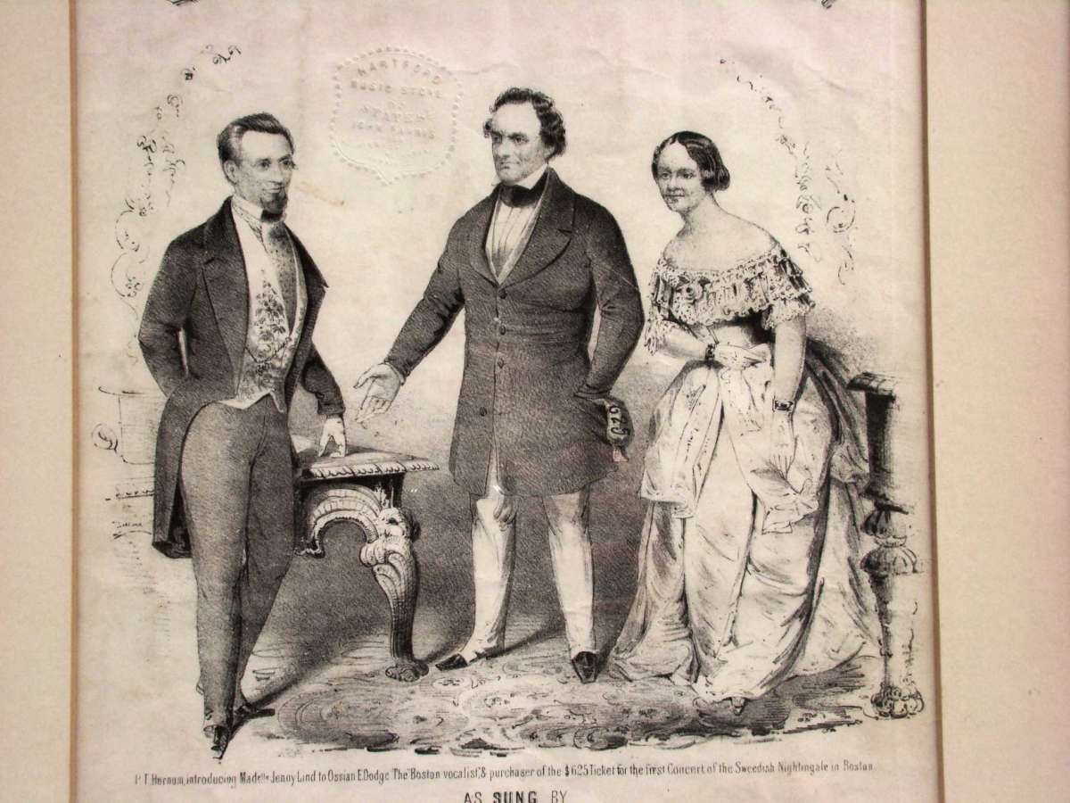 Black and white drawing of P.T. Barnum speaking to another man as Jenny Lind looks on.
