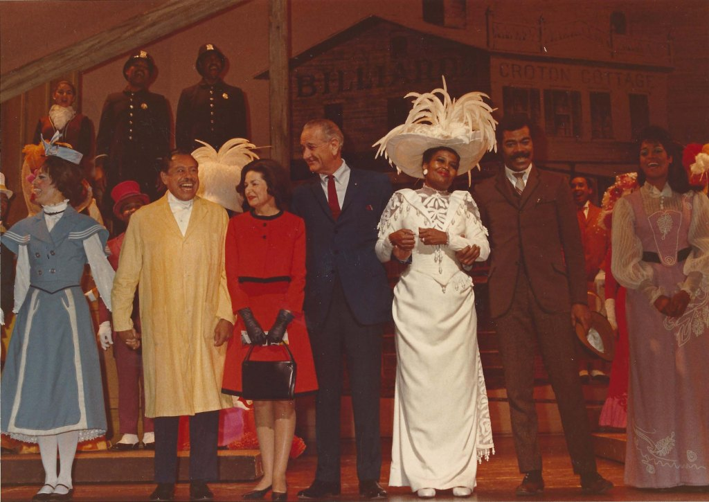 """Pearl Bailey stands with President Lyndon B. Johnson and cast for the curtain call after a performance of """"Hello, Dolly!"""""""