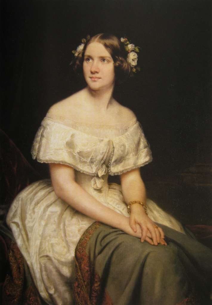Color portrait of Jenny Lind, seated with her hands on her lap.